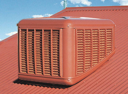 Colour coordinated evaporative air conditioning units are mounted discretely on the roof to deliver cooled and filtered air to rooms and large spaces via ducts and vents, or a plenum.